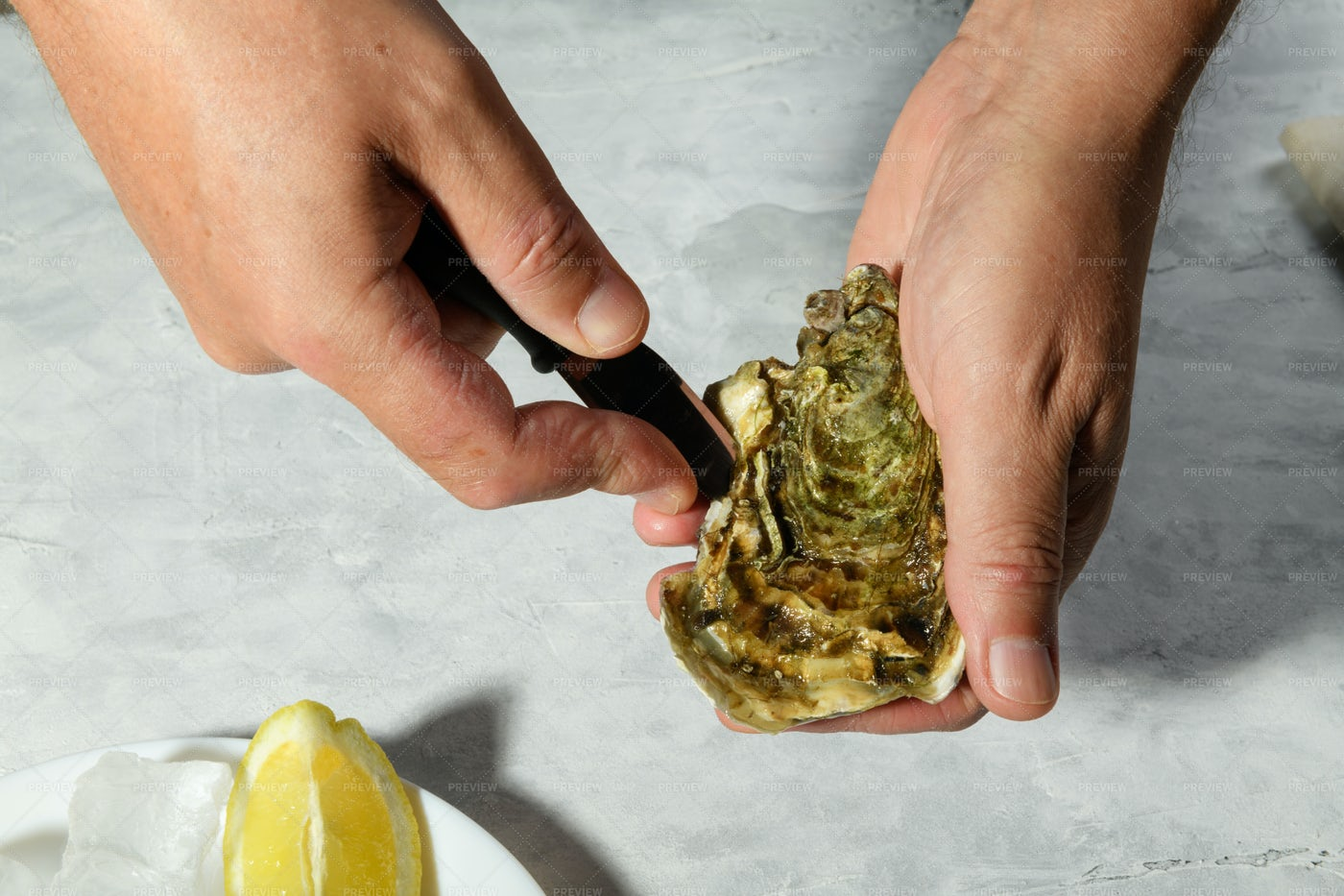 Hands Opening An Oyster: Stock Photos