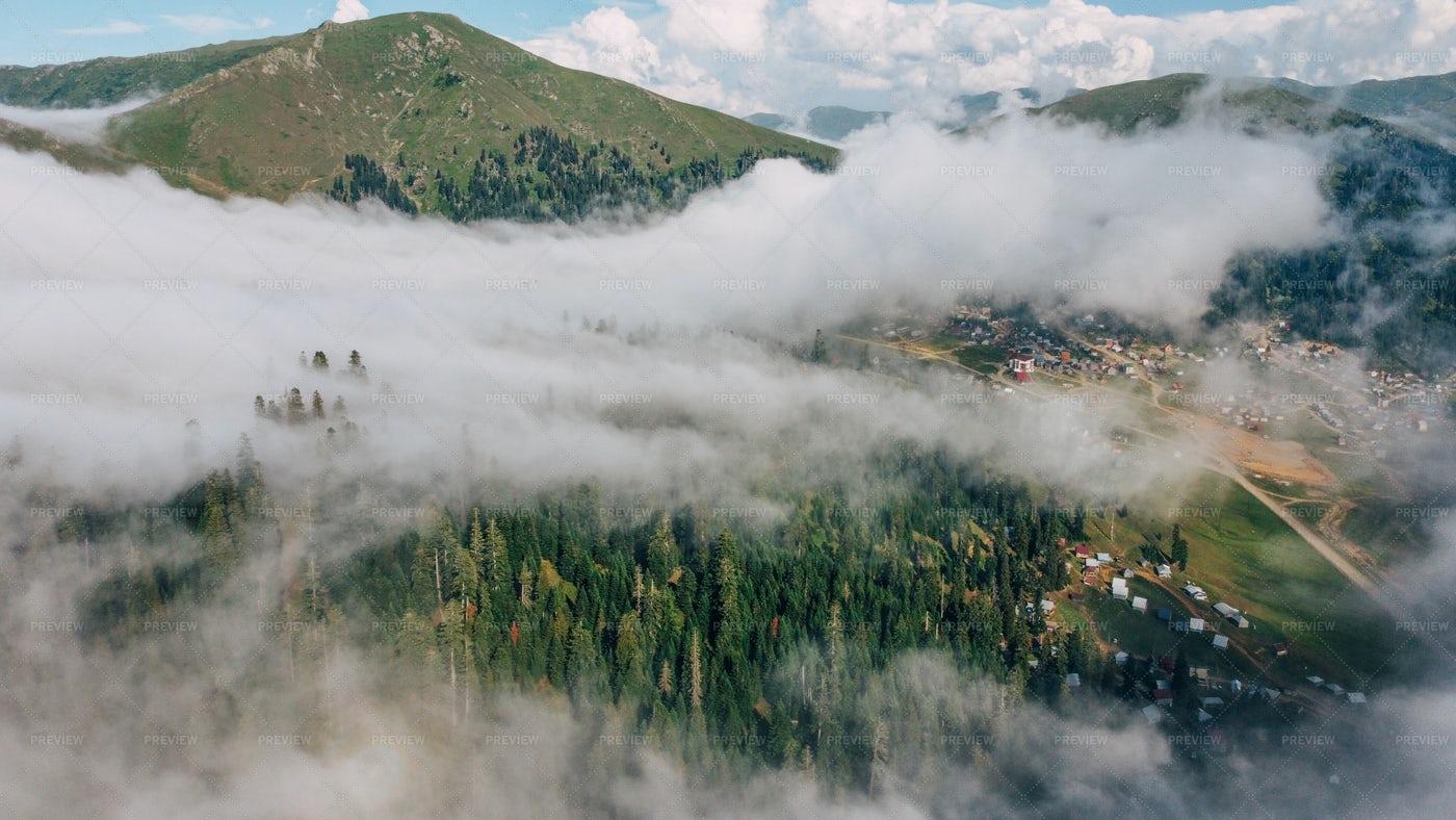 Foggy Mountain Village: Stock Photos