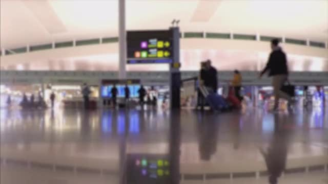 Blurry People In Bright Airport Terminal Interior: Stock Video