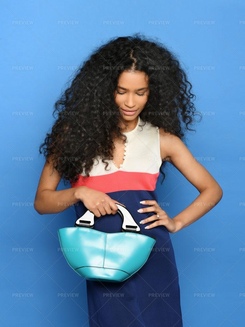 Black Woman Posing With Handbag: Stock Photos