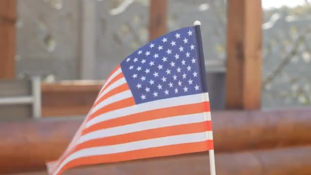 Small American Flag Waving Outdoors: Stock Video