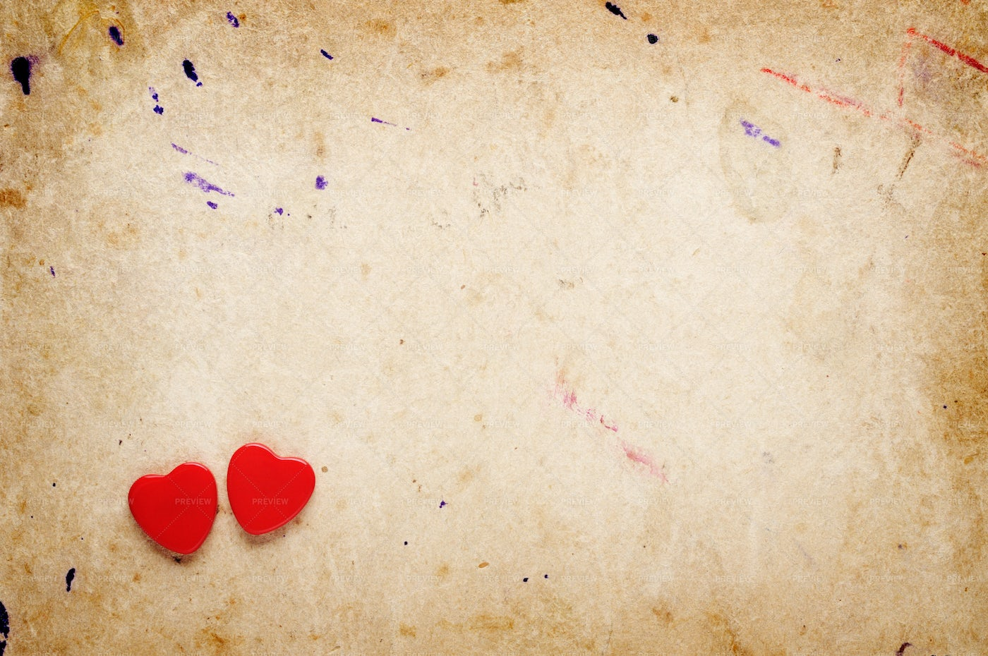 Two Red Hearts On Old Paper Background: Stock Photos