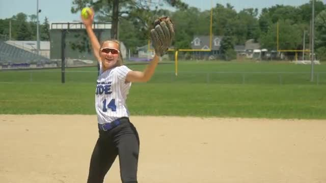 Female Softball Pitcher Warming Up: Stock Video