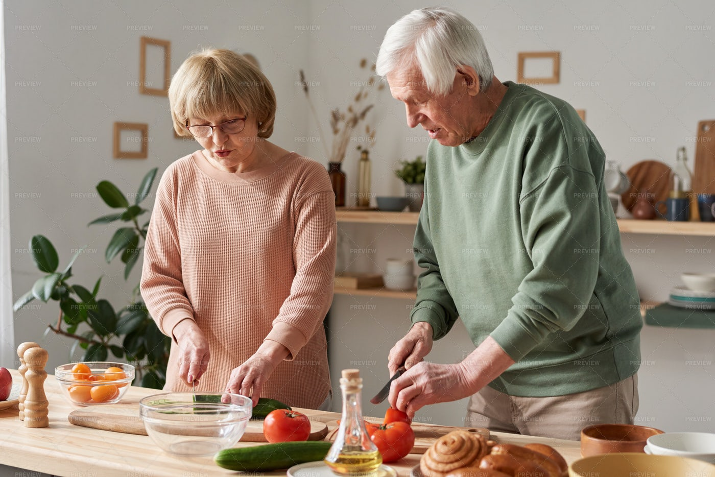 Couple Cutting In Kitchen: Stock Photos