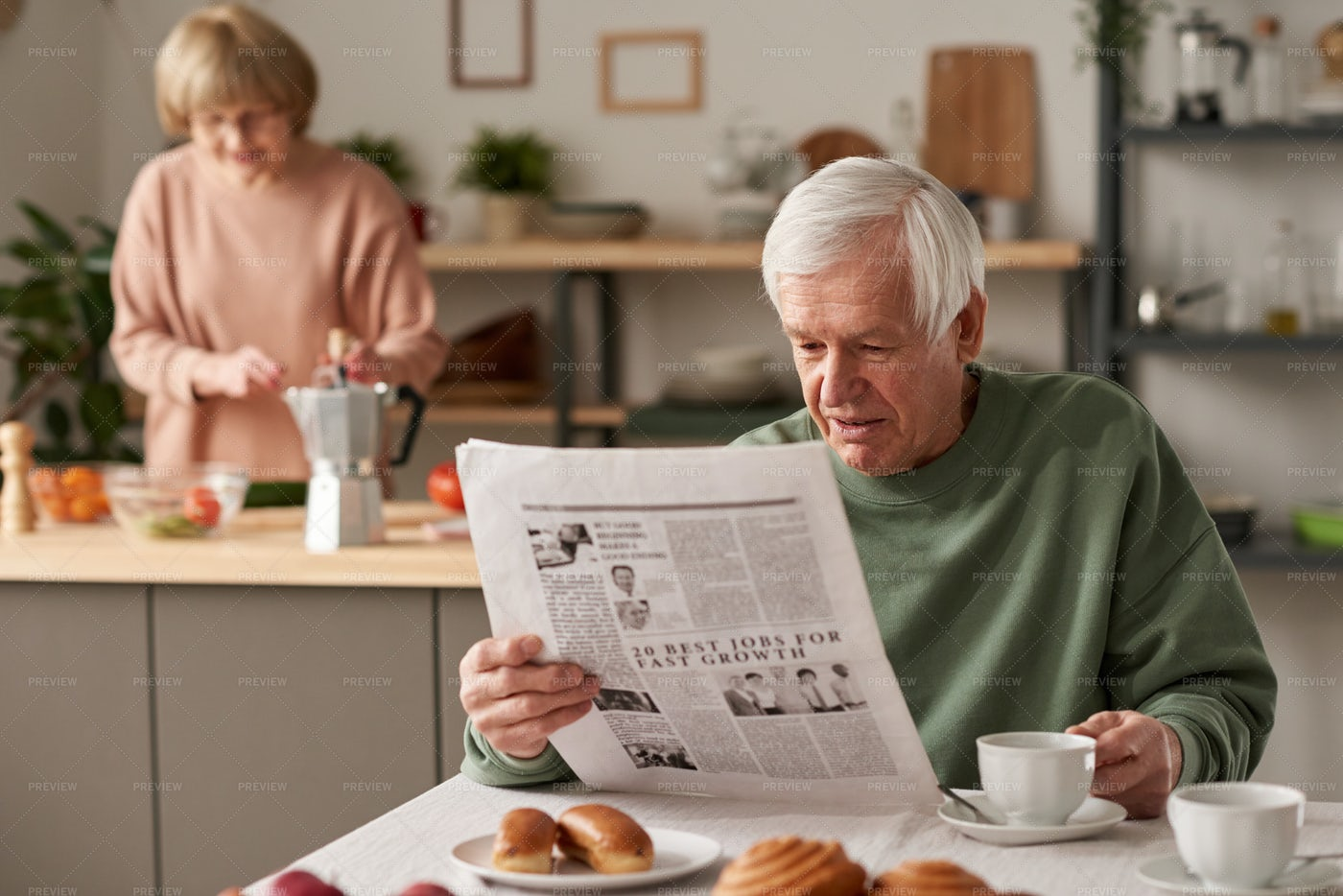 Reading Newspaper In The Morning: Stock Photos
