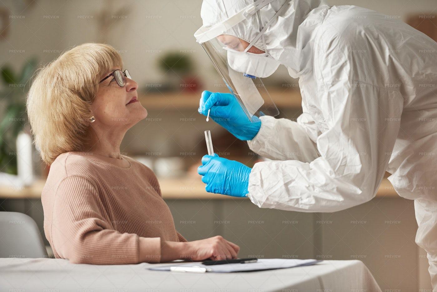 Senior Woman Passing The Coronavirus Tes: Stock Photos