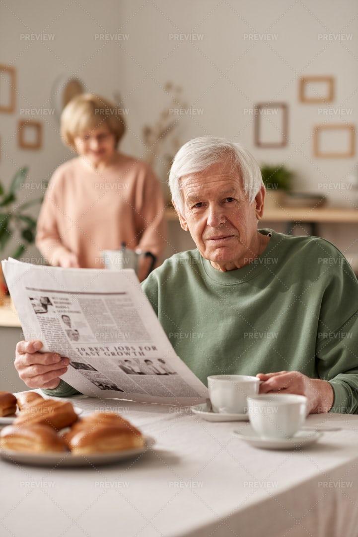 Man Having Breakfast With Newspaper: Stock Photos