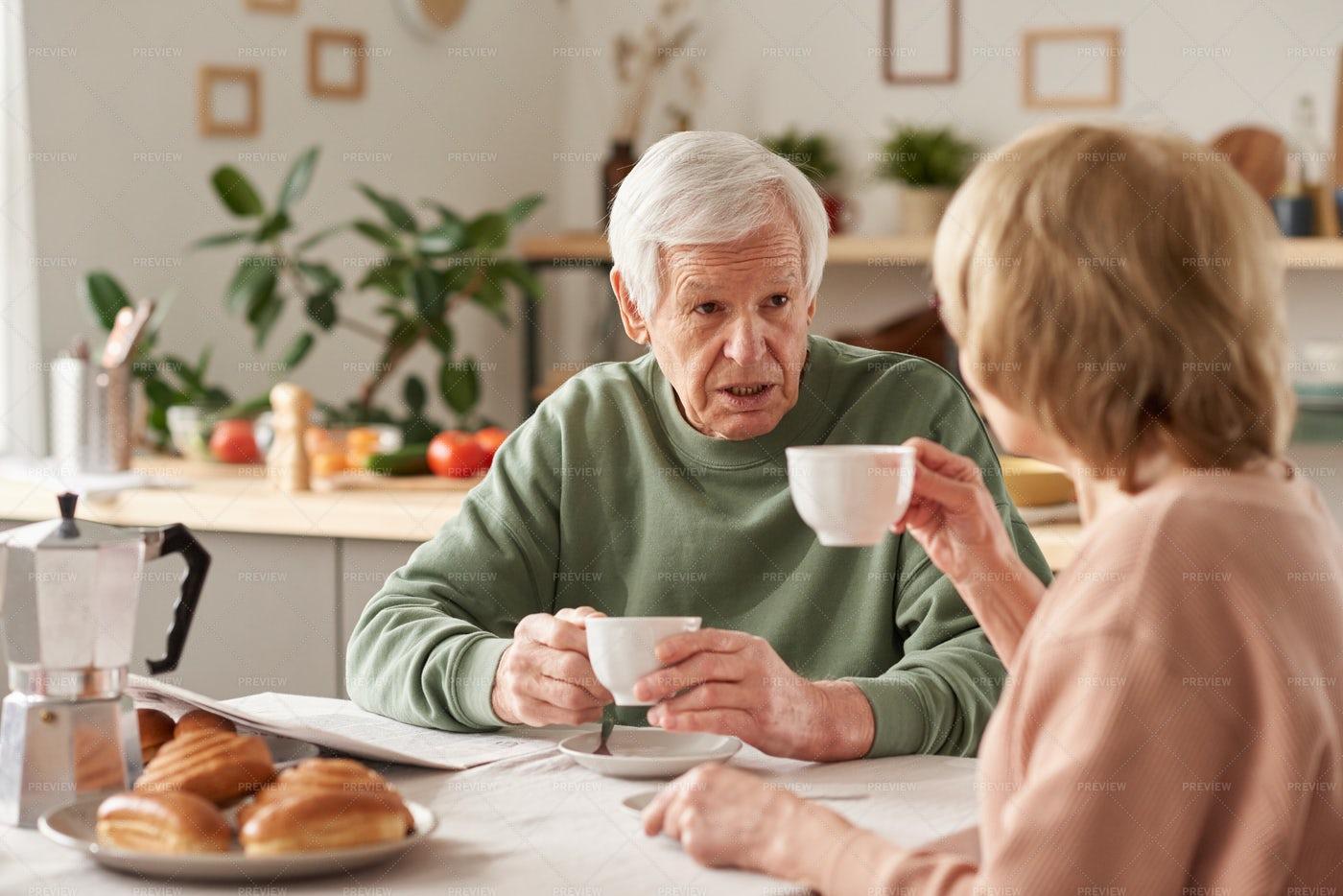 Senior Couple Having Breakfast At Home: Stock Photos