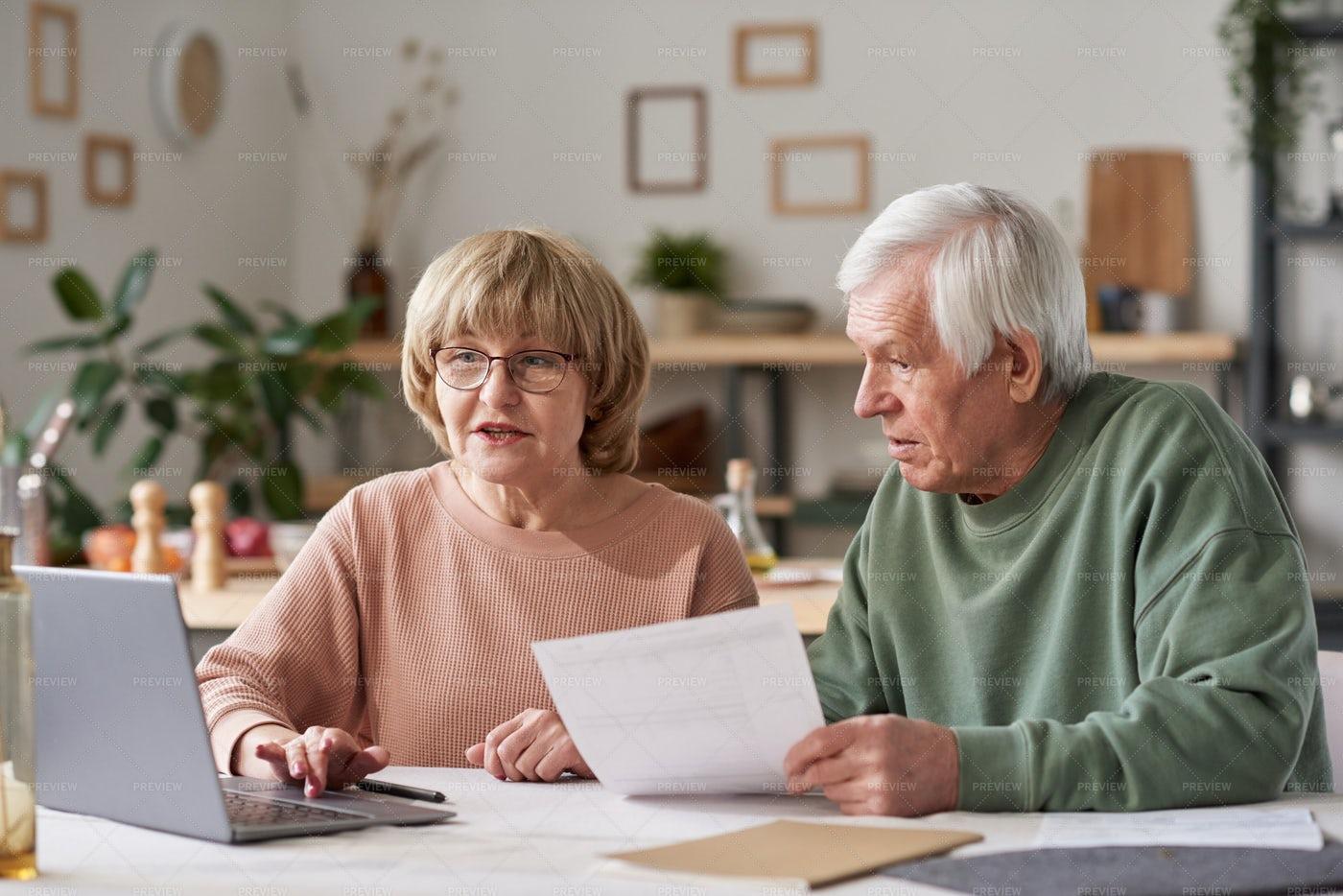 Senior Couple Paying Bills Online: Stock Photos