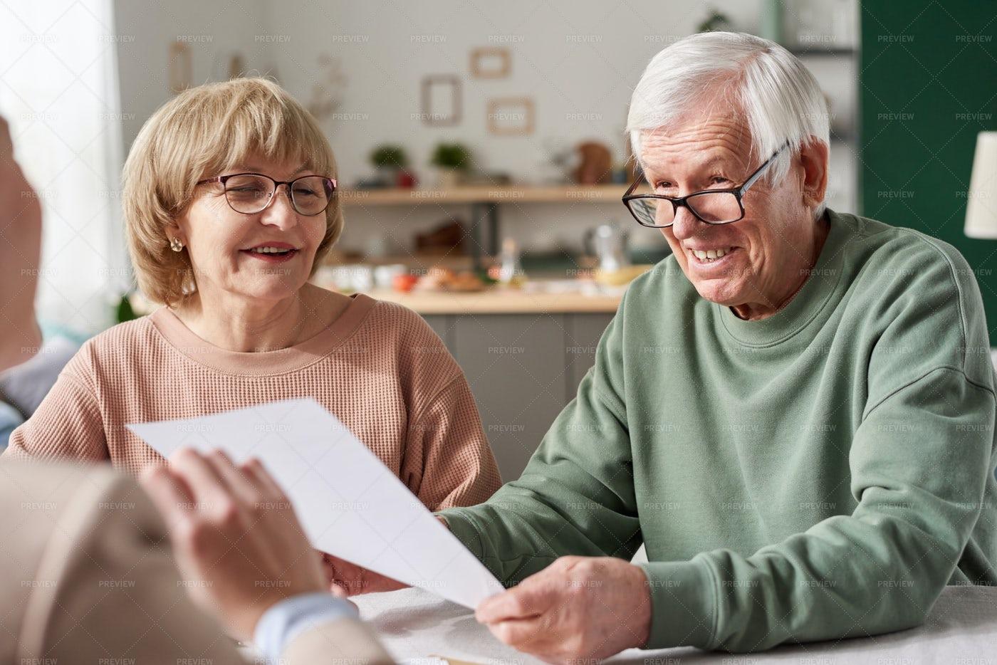 Senior Couple Signing A Contract: Stock Photos