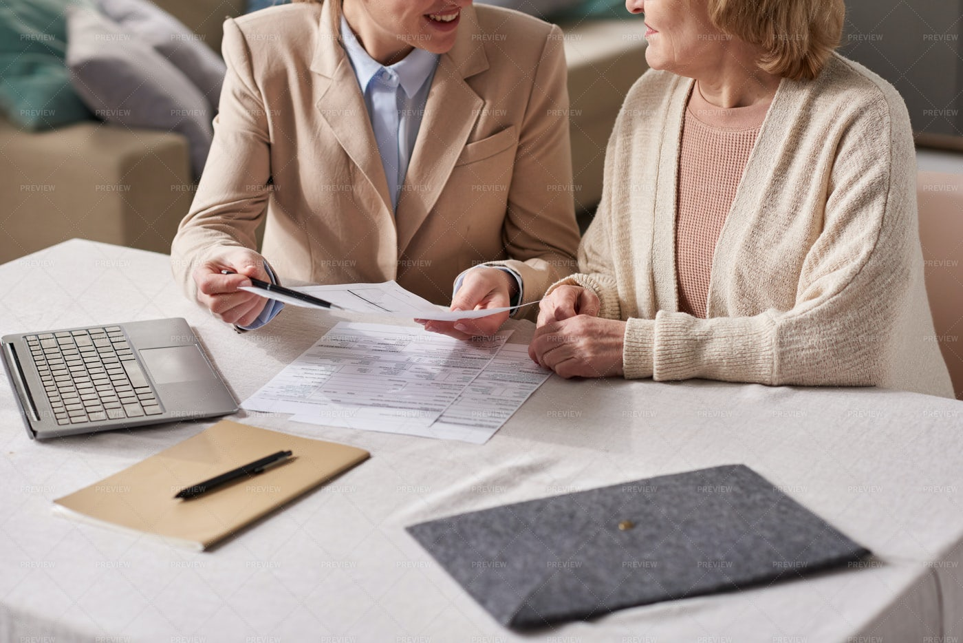 Businesswoman Consulting Senior Woman: Stock Photos