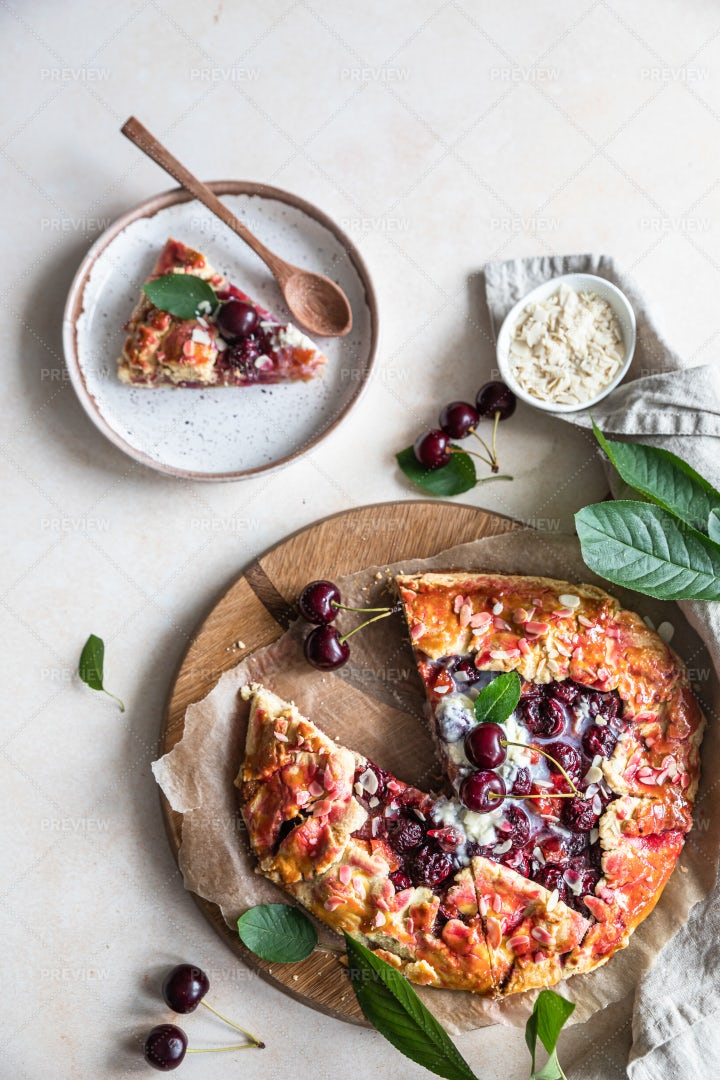Piece Of Galette With Cherry: Stock Photos