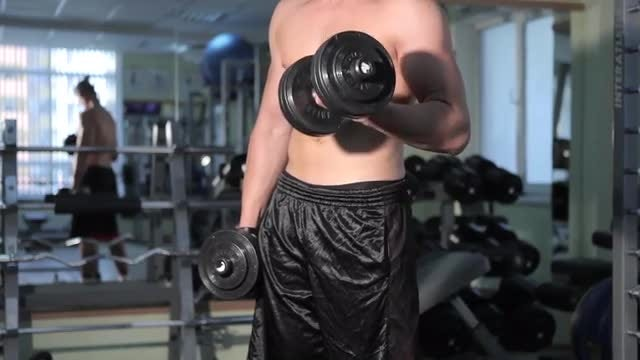 Man Lifting Barbells In Gym: Stock Video