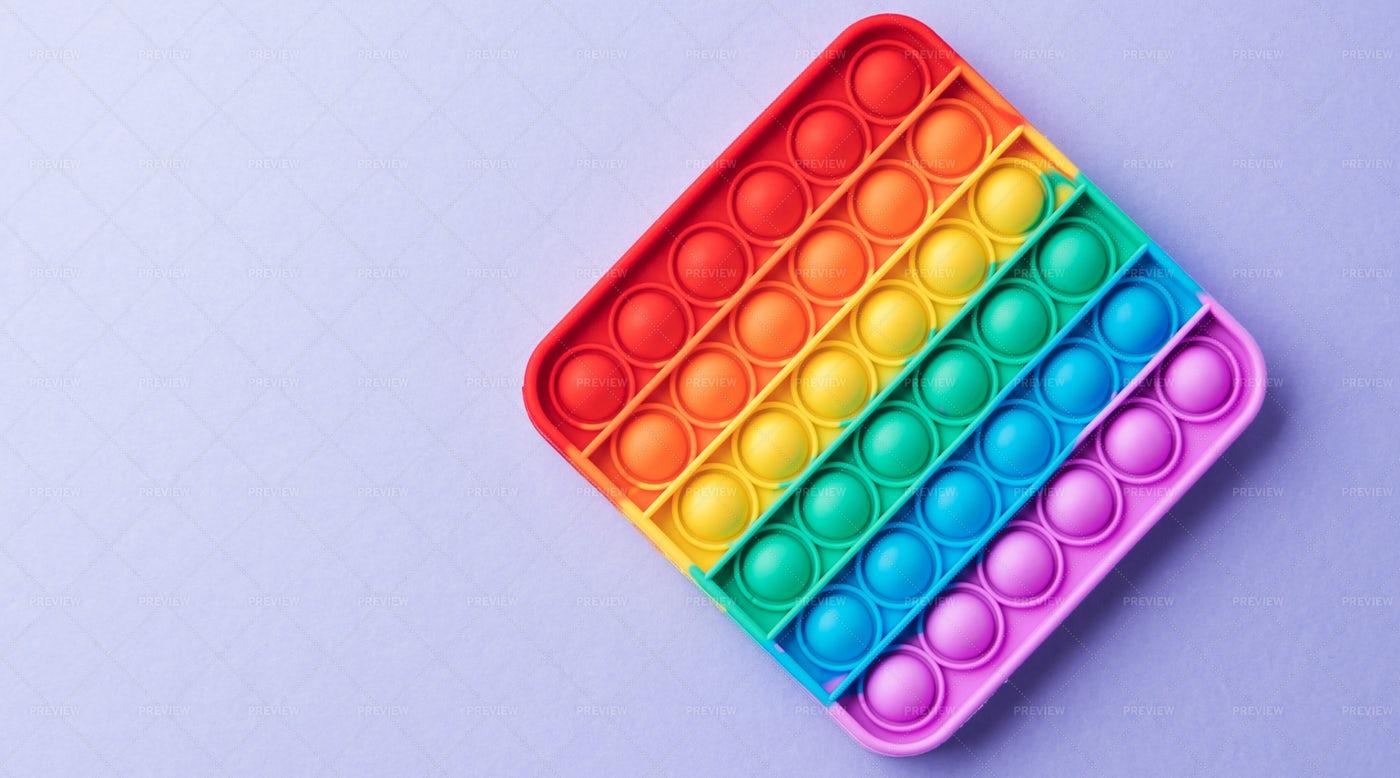 Rainbow Pop It Fidget: Stock Photos