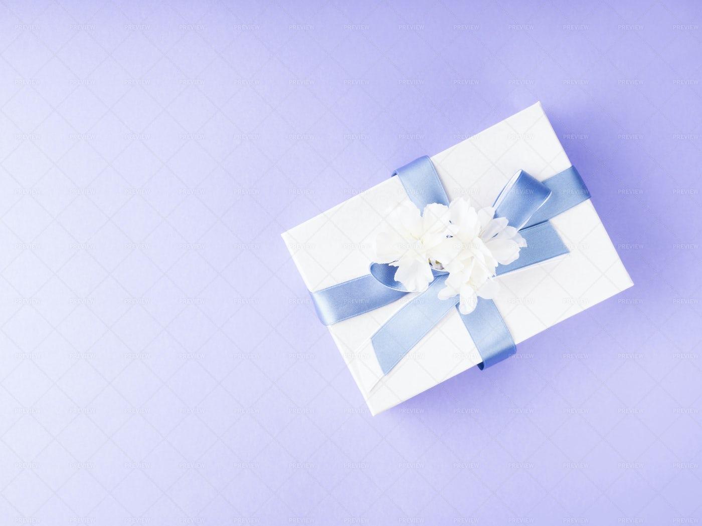 White Gift Box On Purple: Stock Photos