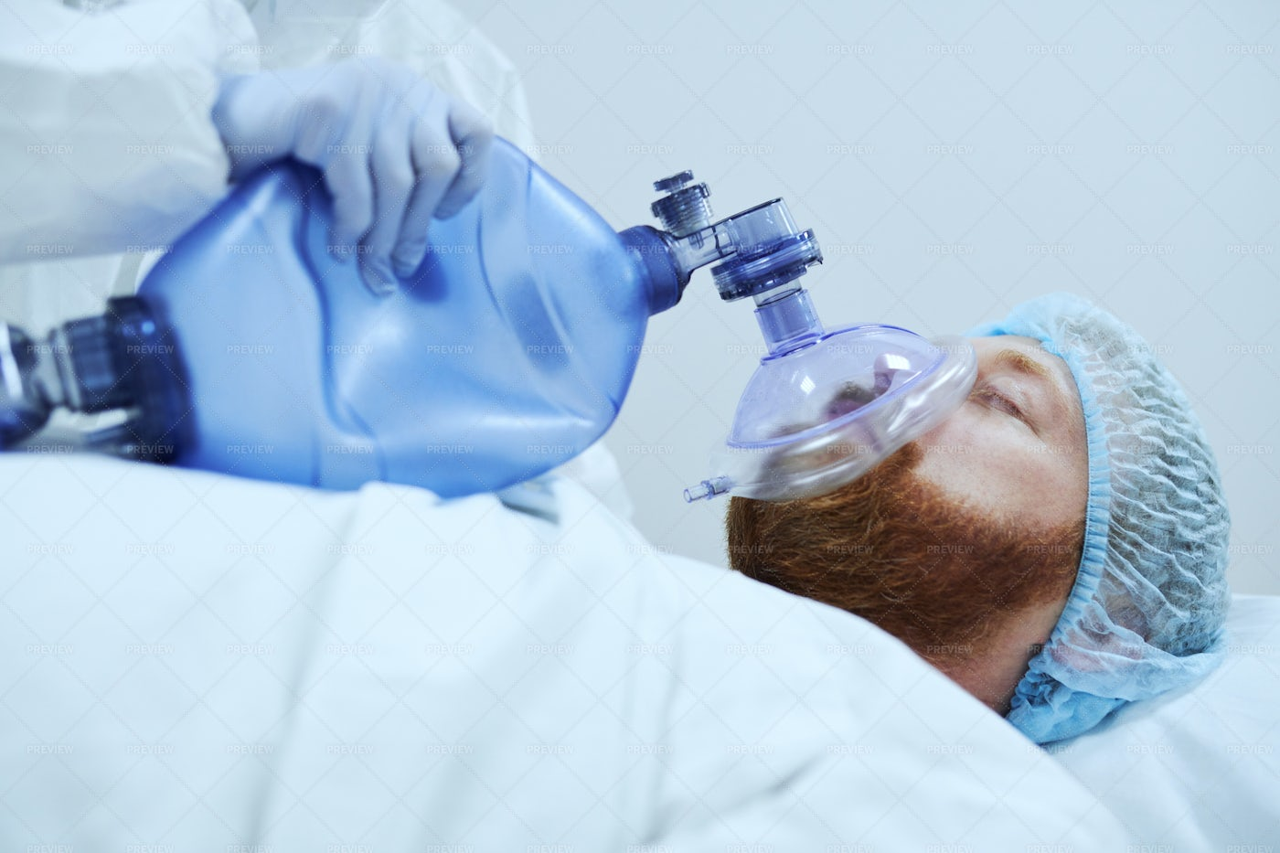 Patient In Oxygen Mask In Operating Room: Stock Photos