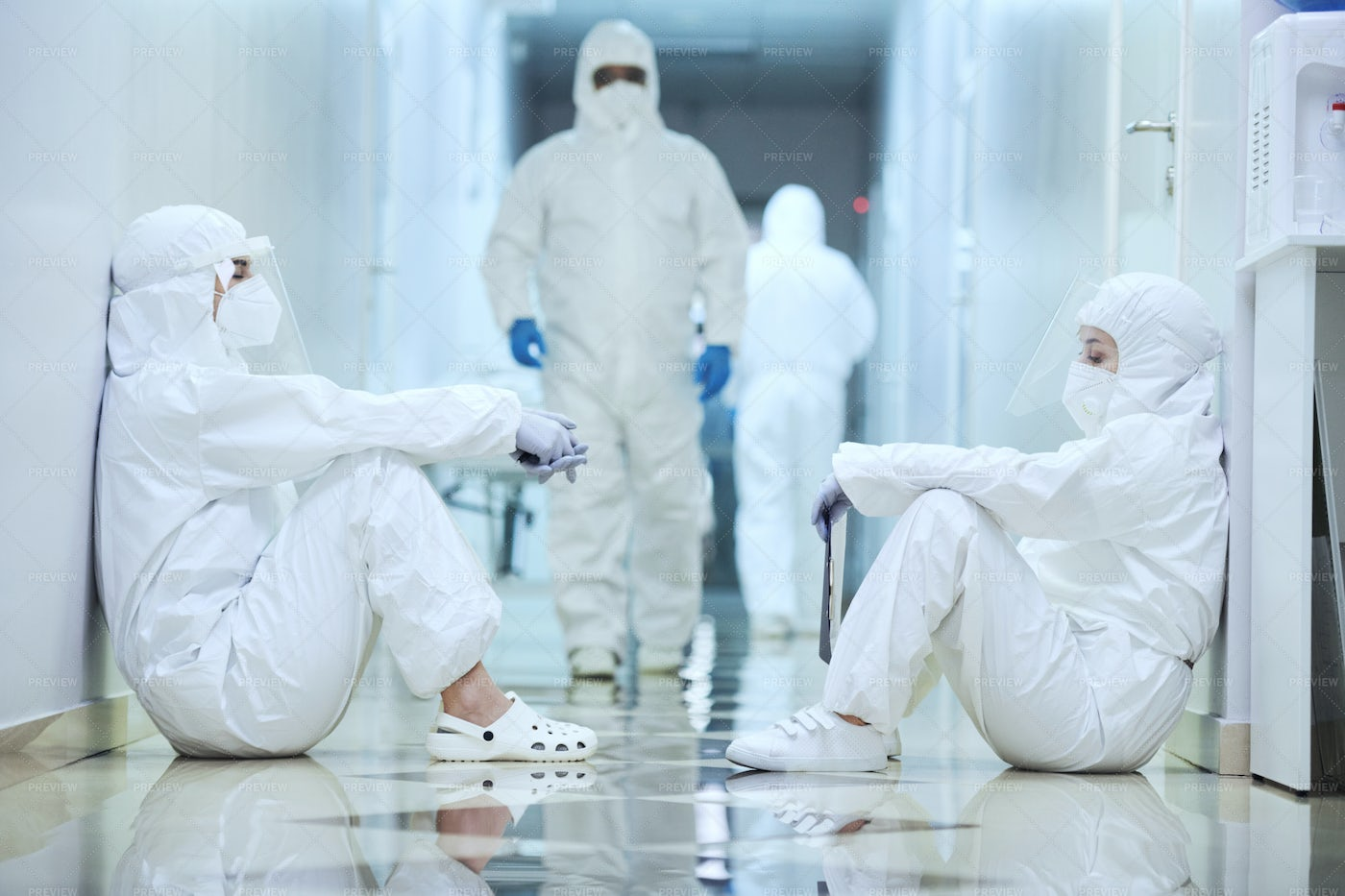 Surgeons In The Corridor During Pandemic: Stock Photos