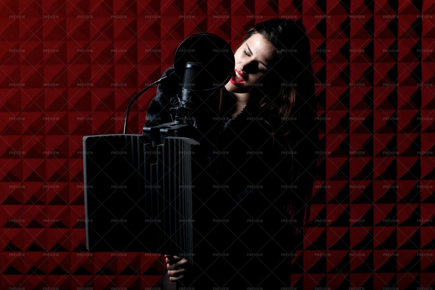 Woman Recording Song: Stock Photos