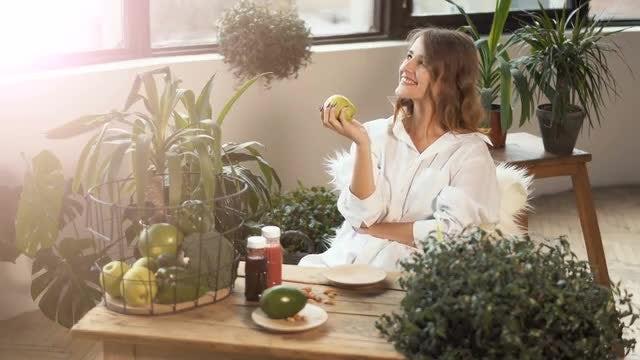 Girl Smells Green Apple: Stock Video