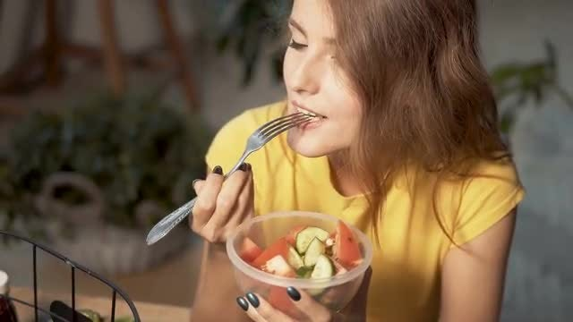 Beautiful Girl Eating Fruit Salad: Stock Video